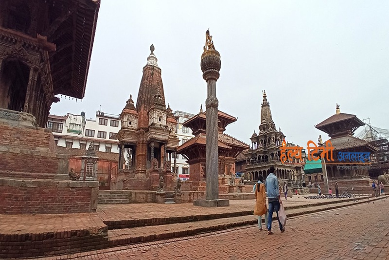 7. A couple their way to home buying morning essentials while few others seen feeding pigeons at the Patan Durbar Square (the UNESCO World Heritage Site)